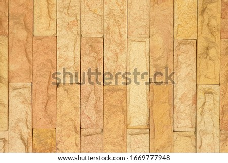 Brown synthetic stone for stone wall decoration background. Background texture. #1669777948