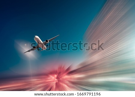 Airplane flying with dynamic colorful motion blur abstract background #1669791196