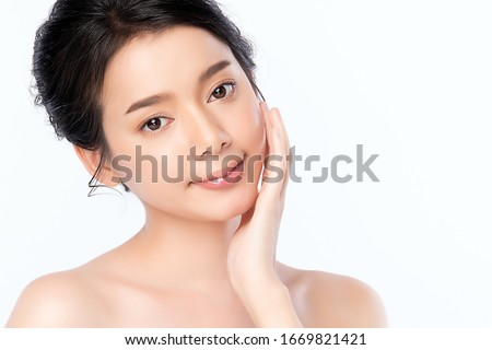 Beautiful Young Asian Woman with Clean Fresh Skin. Face care, Facial treatment, Cosmetology, beauty and healthy skin and cosmetic concept .woman beauty skin isolated on white background. #1669821421