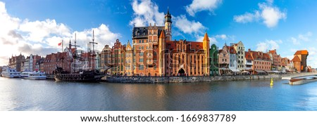 Panorama of the facades of old medieval houses on the promenade in Gdansk. Poland. Royalty-Free Stock Photo #1669837789