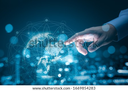 Businessman hand touching global network and data exchanges over the world 3D rendering #1669854283