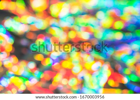 Delicate glitter bokeh rainbow background. Creative and moody color of the picture. Blurred texture.