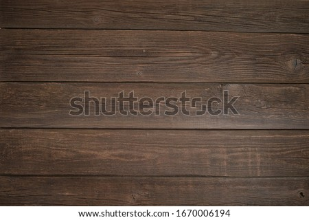 dark old wooden texture with cracks and knots #1670006194