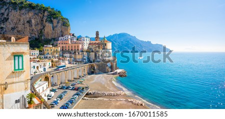 Panoramic view of small town Atrani on Amalfi Coast in province of Salerno, Campania region, Italy. Amalfi coast is popular travel and holyday destination in Italy.  Royalty-Free Stock Photo #1670011585