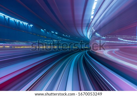 Blue and purple abstract high speed curved movement toward to the future, just around the corner, concept. Royalty-Free Stock Photo #1670053249