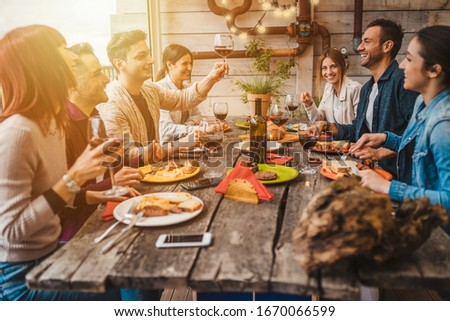 Group of young people having lunch on a terrace of an apartment at sunset - Millennials have fun together on a day of celebration #1670066599