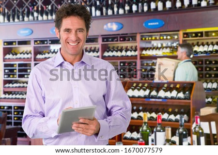 Portrait Of Wine Store Owner With Digital Tablet #1670077579