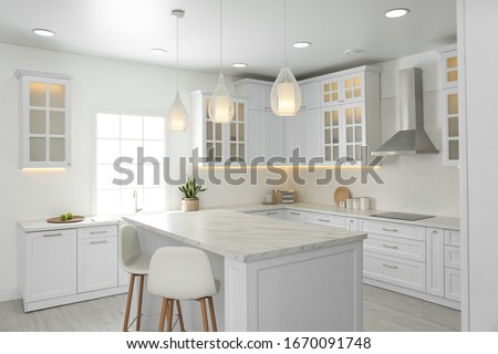Beautiful kitchen interior with new stylish furniture Royalty-Free Stock Photo #1670091748