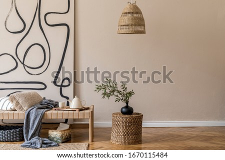 Interior design of oriental style living room with modern chaise longue, pillows, plaid, rattan decoration, elegant personal accessories and modern paintings on the beige wall.  #1670115484