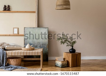 Interior design of oriental style living room with modern chaise longue, wooden cube, pillow plaid, rattan decoration, tea pot and elegant personal accessories in stylish home decor.  Royalty-Free Stock Photo #1670115487