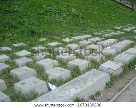 Monument to the keyboard, keys in green grass with Russian and English layout #1670130838