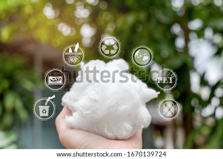Hand holding Polyester stable fiber with green background,recycle icon,picking up&wash Plastic Bottle,Protect the earth icon,PET icon&Yarn icon.Chemical concept #1670139724