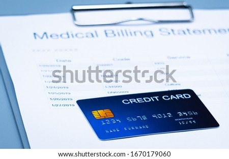 top view picture of medical billing statement, cradit card  on the gray background