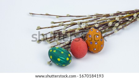 Easter eggs. Happy easter card. Multi-colored Easter eggs with willow. Easter eggs on a white background. Copy space. Place for text