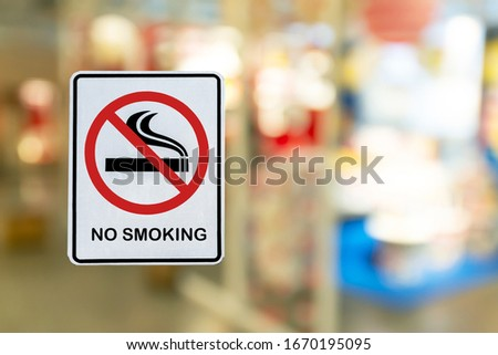 No Smoking label in the public with blur nature background.