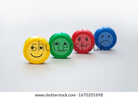 A variety of emotions: joy, serenity, anger, sadness on the colored cubes Royalty-Free Stock Photo #1670201698