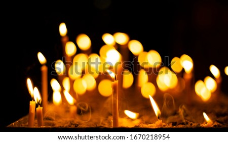 candle fire yellow illumination flame in christian church darkness space spiritual atmosphere concept background picture divine worship time