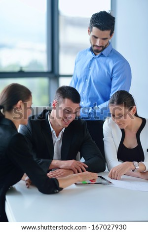 Group of happy young  business people in a meeting at office #167027930
