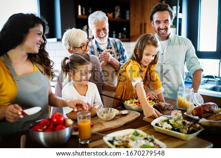 Grandparents, parents and children spending happy time in the kitchen #1670279548