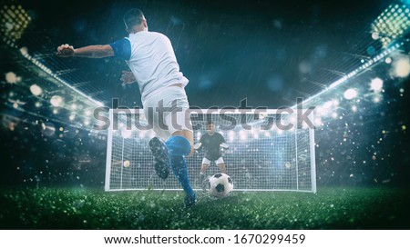 Soccer scene at night match with player in a white and blue uniform kicking the penalty kick Royalty-Free Stock Photo #1670299459
