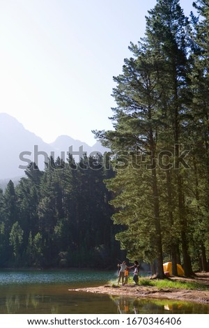 Family camping in forest fishing in lake #1670346406