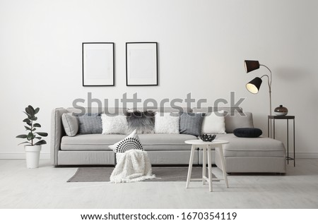 Stylish living room interior with comfortable sofa Royalty-Free Stock Photo #1670354119
