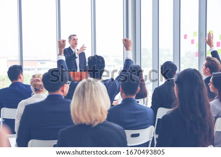 Group of business people or employees meeting or seminar in office hall, executive or professional smart speaker speaking on podium  #1670493805