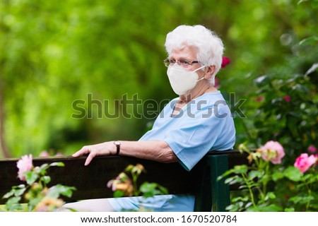Senior woman wearing face mask during corona virus and flu outbreak. Disease and illness protection. Surgical masks for coronavirus prevention. Sick elderly patient coughing. Ill person. Royalty-Free Stock Photo #1670520784