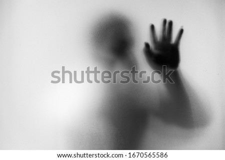 Shadow blur of man wear mask to prevent infection background.Fight against communicable diseases covid-19.Black and white picture.Blur picture.Fight deadly communicable diseases coronavirus.Soft focus