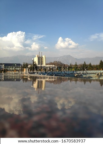 This picture is taken at university of kashmir, india. In the picture mesmerizing beauty of Allama Iqbal library can be seen. the reflection on marble can be seen