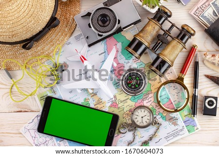 Accessories and items for traveling on the table in composition #1670604073