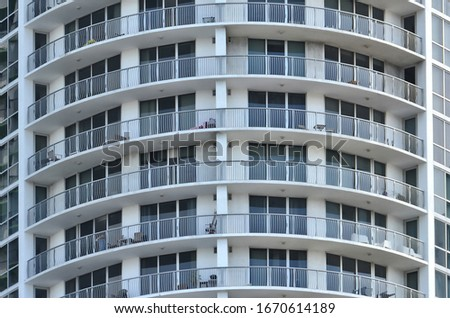 Skyscraper. Close up. Architecture. Modern building with balconies. Real estate. Block of flats. Urban landscape #1670614189