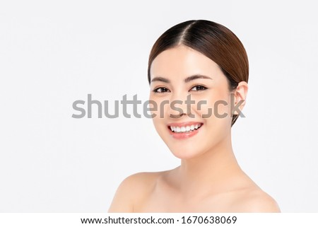 Beauty shot of smiling beautiful Asian woman isolated on white background Royalty-Free Stock Photo #1670638069