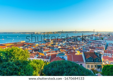 Sunset view of cityscape of Lisbon with Praca do Comercio square, Portugal #1670684533