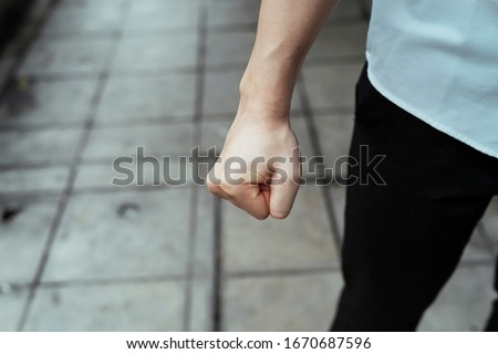A fist of angry business man, right hand. Furious fist from the businessman. Royalty-Free Stock Photo #1670687596