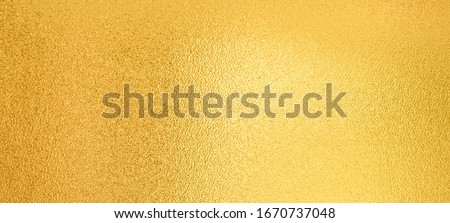 Gold background. Luxury shiny gold texture