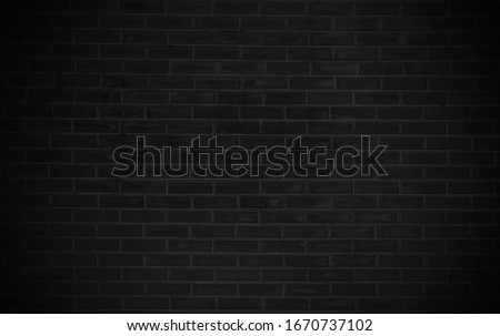 Black brick texture background. Abstract old brick wall surface as used for background, wallpaper and graphic web design