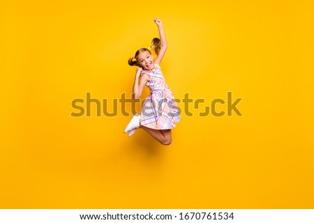 Full length photo of cheerful kid jump enjoy rejoice win lottery sales raise fists scream yeah wear checkered skirt isolated bright shine color background #1670761534