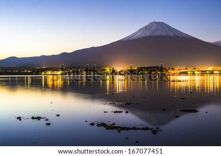 Mt. Fuji at dusk over Lake Kawaguchi in Japan. #167077451