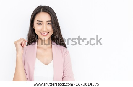 Portrait of smiling confident asian business woman in pink suit office. Asian business girl. Startup successful power business leader executive people looking camera with copy space isolated on white #1670814595