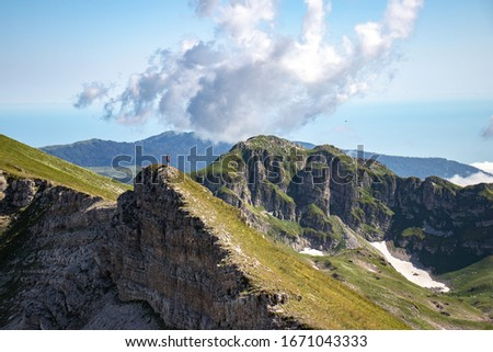 Man standing on top of a mountain #1671043333