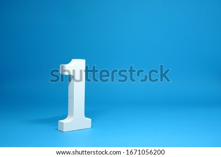 No. 1 ( One ) Isolated Blue  Background with Copy Space - Number 1 Percentage or Promotion success and the best winner Concept - First onject Royalty-Free Stock Photo #1671056200