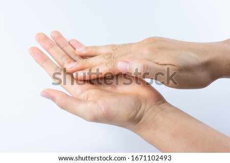 Man hands using wash hand sanitizer gel pump dispenser for protection coronavirus and bacteria, health care concept #1671102493
