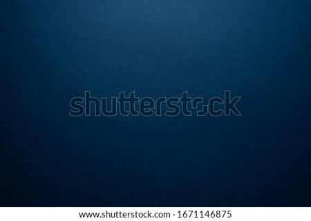 Empty dark blue background. Dark blank with a slight glow.