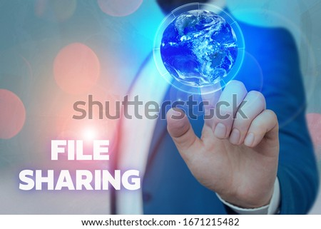 Text sign showing File Sharing. Conceptual photo transmit files from one computer to another over a network Elements of this image furnished by NASA. #1671215482
