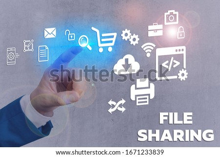 Text sign showing File Sharing. Conceptual photo transmit files from one computer to another over a network. #1671233839