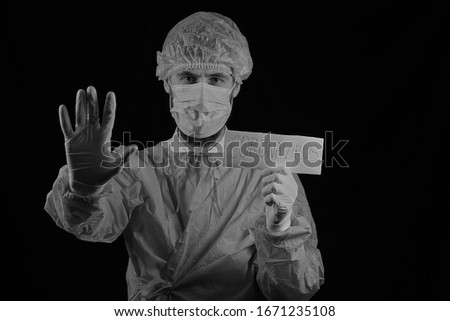 The concept of preventing the spread of the epidemic and treating coronavirus. The doctor points to a test tube with a blood test. Coronavirus treatment. Virologist. Doctor Black and white photo. #1671235108