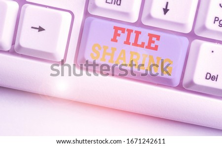 Text sign showing File Sharing. Conceptual photo transmit files from one computer to another over a network. #1671242611