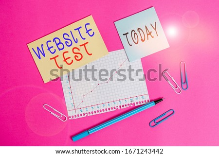 Word writing text Website Test. Business concept for test the websites or web applications for potential bugs Stationary and note paper plus math sheet with diagram picture on the table.