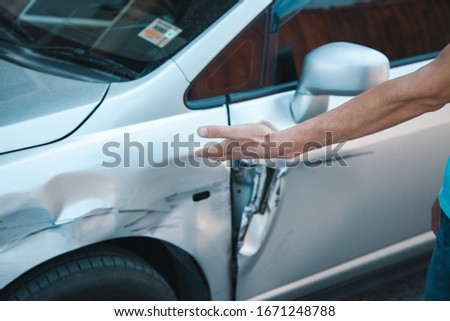sad man with car accident in street #1671248788